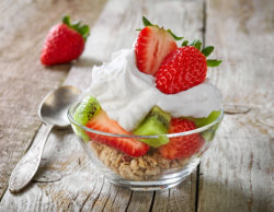 fruits and berries with whipped cream